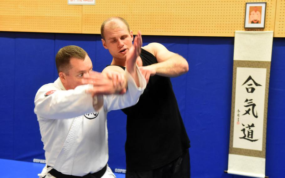 Base chaplain Maj. Kevin Hovan, left, demonstrates an aikido move on Pfc. Nikolas Petrosyan during an aikido class at Grafenwoehr, Germany, Tuesday, Oct. 24, 2017.