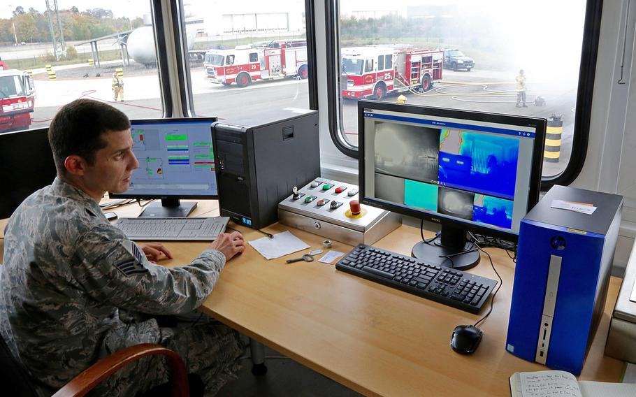 Staff Sgt. Alberto Garcia-Vidal monitors other firefighters in a burn house by computer during training on Ramstein Air Base, Germany on Tuesday, Oct. 24, 2017. Garcia-Vidal distinguished himself recently as one of a group of 145 Red Cross volunteers who helped man a call center for victims of Hurricane Maria.