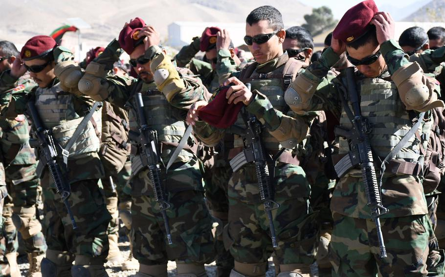 New Afghan commandos put on the signature maroon beret for the first time at a graduation ceremony in Kabul on Wednesday, Oct. 25, 2017.