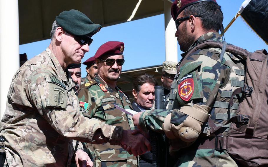 Army Maj. Gen. James B. Linder, commanding general of Special Operations Joint Task Force-Afghanistan, left, congratulates a newly graduated Afghan commando at a ceremony in Kabul on Wednesday, Oct. 25, 2017.