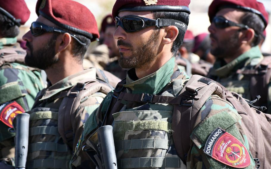 New Afghan special forces commandos attend a graduation ceremony in Kabul on Wednesday, Oct. 25, 2017.