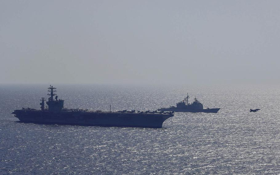 The aircraft carrier USS Nimitz and the Ticonderoga-class guided-missile cruiser USS Vella Gulf patrol the Arabian Gulf, Oct. 20, 2017.