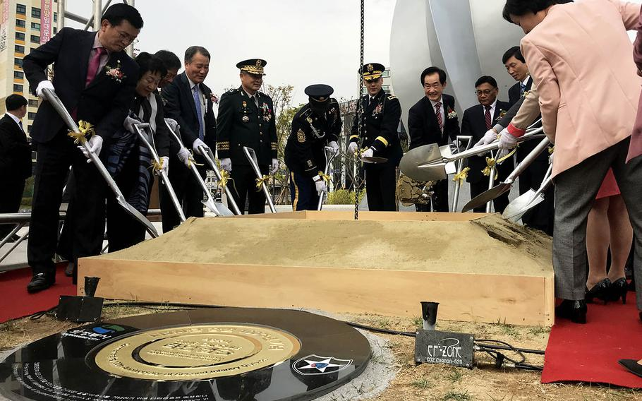Officials from Uijeongbu, South Korea, and the 2nd Infantry Division bury a time capsule at Camp Casey, South Korea, Thursday, Oct. 26, 2017.