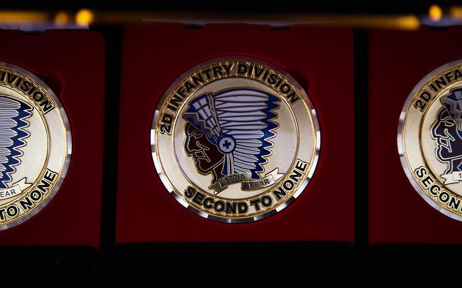 A 100th anniversary challenge coin for the 2nd Infantry Division is displayed at Camp Casey, South Korea, Thursday, Oct. 26, 2017.