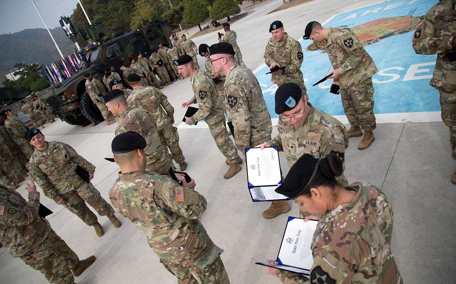 Recently re-enlisted soldiers review their certificates at Camp Casey, South Korea, Thursday, Oct. 26, 2017.