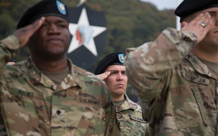 Soldiers salute the flag at Camp Casey, South Korea, Thursday, Oct. 26, 2017.