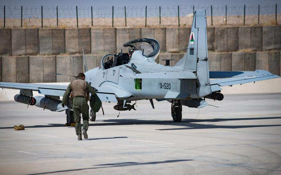 An Afghan A-29 pilot walks toward his aircraft at Kandahar Airfield, Afghanistan, Sept. 10, 2017. The Afghan Air Force plans and conducts all A-29 combat missions throughout Afghanistan.