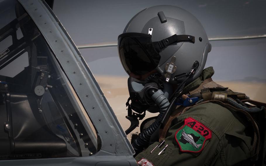 An Afghan A-29 pilot prepares for flight at Kandahar Airfield, Afghanistan, Sept. 10, 2017.