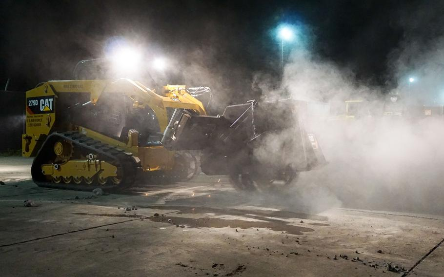 Sparks and dust fly as airmen from the 374th Civil Engineer Squadron at Yokota Air Base, Japan, cut into a simulated flight line with a concrete saw during a rapid airfield damage repair exercise early Friday, Oct. 27, 2017.