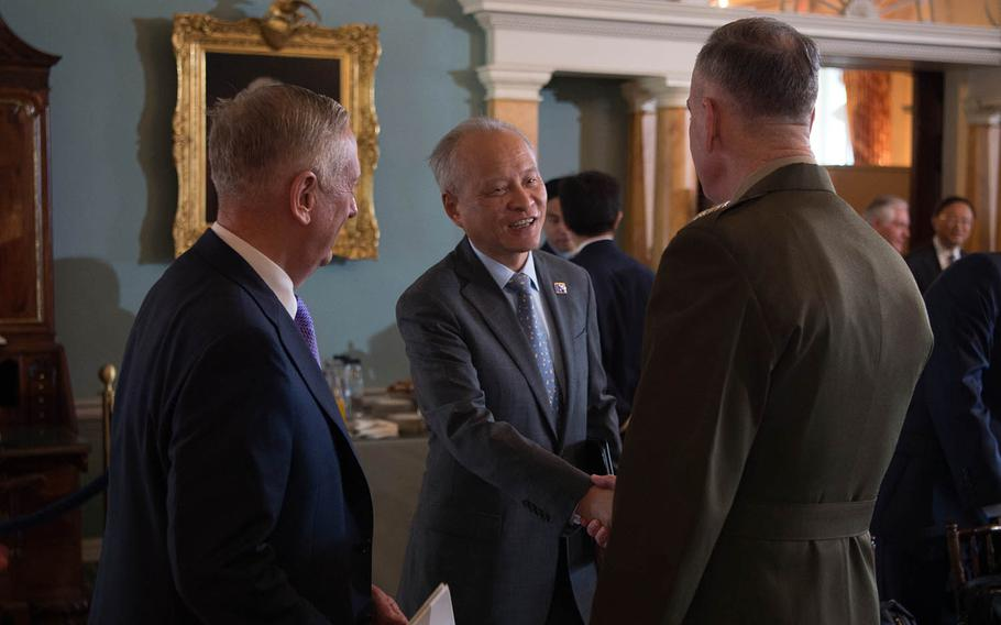 Defense Secretary Jim Mattis, left, and Marine Corps Gen. Joseph Dunford, chairman of the Joint Chiefs of Staff, speak with Chinese Ambassador to the U.S. Cui Tiankai at the State Department in Washington, D.C., June 21, 2017.