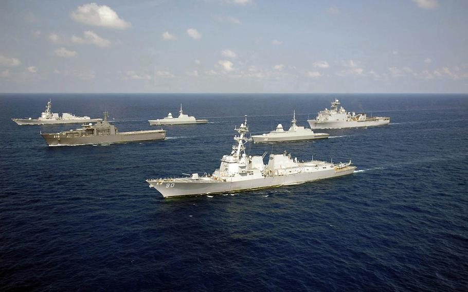 The guided-missile destroyer USS Chafee, foreground, sails with the USS Chung-Hoon and Singapore navy ships during past Cooperation Afloat Readiness and Training in the South China Sea.