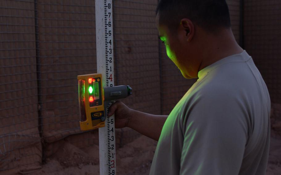 Staff Sgt. Andrew Elgar, observes a reading from a laser level at Nigerien Air Base 201, Niger, May 9, 2017.