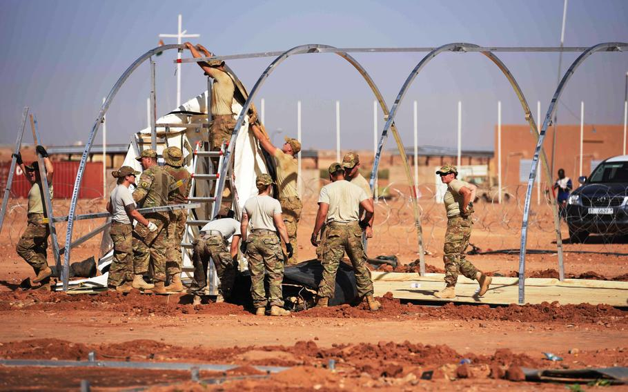 Airmen from the 724th Expeditionary Air Base Squadron take down tents at Air Base 201 in Agadez, Niger, to move to a new location Sept. 11, 2017.