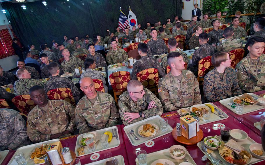Troops wait for U.S. and South Korean leaders Donald Trump and Moon Jae-in to join them for lunch at Camp Humphreys, South Korea, Tuesday, Nov. 7, 2017.