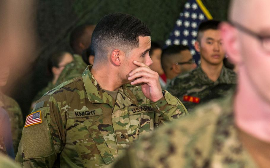 The American soldier who sat next to President Donald Trump during lunch at Camp Humphreys, South Korea, waits for the U.S. leader to arrive, Tuesday, Nov. 7, 2017.