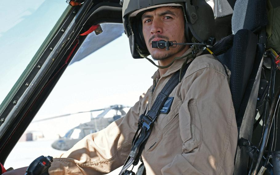 Capt. Zabihullah Dorandish, who is training to fly the UH-60A Black Hawk, finishes practicing maneuvers at Kandahar Air Field, Afghanistan, on Sunday, Nov. 5, 2017.