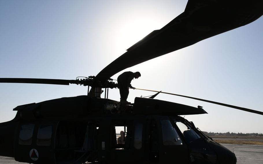 An Afghan trainee UH-60 pilot performs a pre-flight check on his aircraft at Kandahar Air Field before practicing maneuvers on Sunday, Nov. 5, 2017.