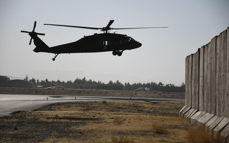 An Afghan pilot practices flying one of Afghanistan's new UH-60 Black Hawk helicopters at Kandahar Air Field on Sunday, Nov. 5, 2017. The U.S. is in the process of giving the Afghans 159 Black Hawks to replace their aging fleet of Russian-made Mi-17 helicopters.