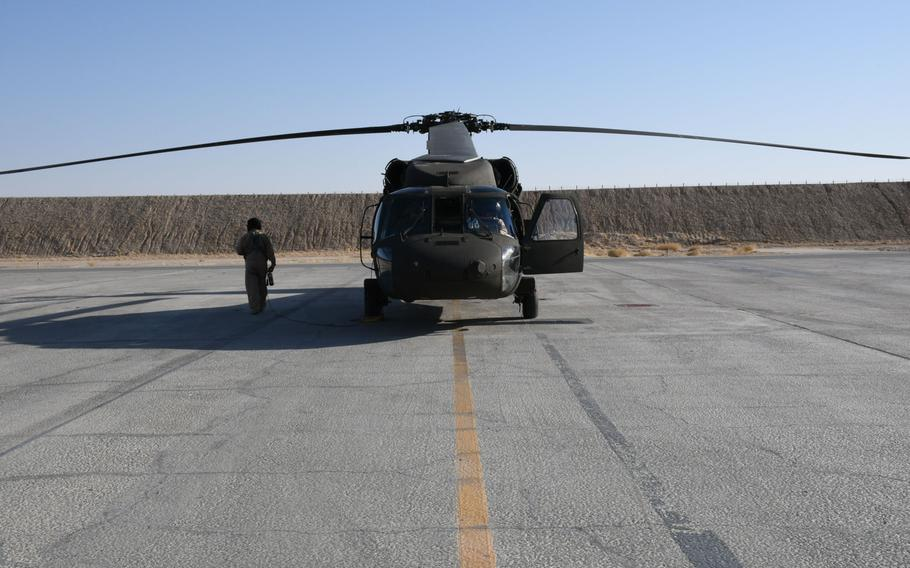 An American contractor prepares a UH-60 Black Hawk for flying on Sunday, Nov. 5, 2017. Six Afghans are currently training to fly the aircraft, which will eventually replace their air force's fleet of Russian-made Mi-17 helicopters.