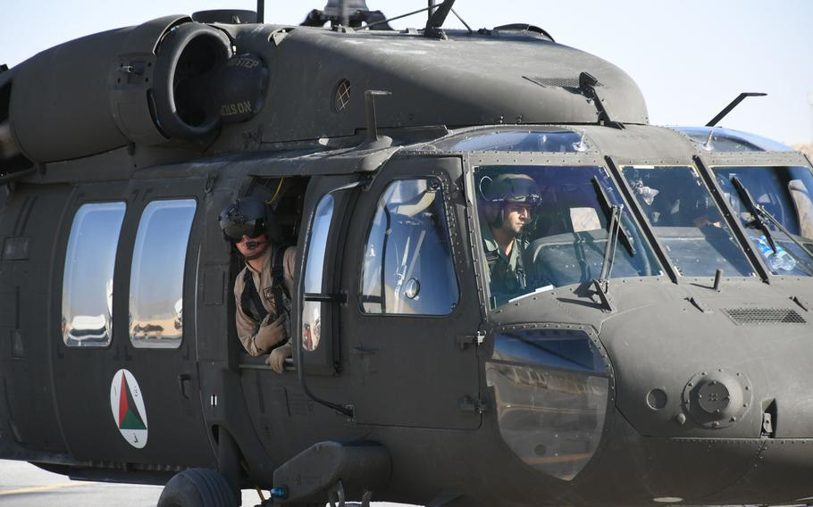 An Afghan pilot trains with American contractors on a UH-60 Black Hawk at Kandahar Air Field on Sunday, Nov. 5, 2017.