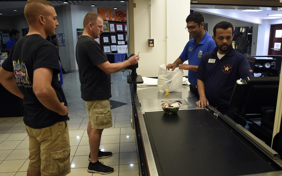 Customers shop at the Navy Exchange in Bahrain on Nov. 8, 2017. Beginning Nov. 11, 2017, veterans will be allowed to shop online at military exchanges.
