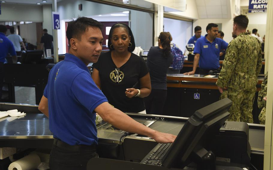 Customers shop at the Navy Exchange in Bahrain on Nov. 8, 2017. Beginning Saturday, Nov. 11, 2017, veterans will be allowed to shop online at military exchanges.