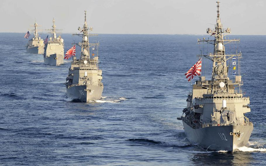 Navy and Japanese Maritime Self-Defense Force ships take part in a three-carrier strike force exercise east of the Korean Peninsula, Sunday, Nov. 12, 2017.