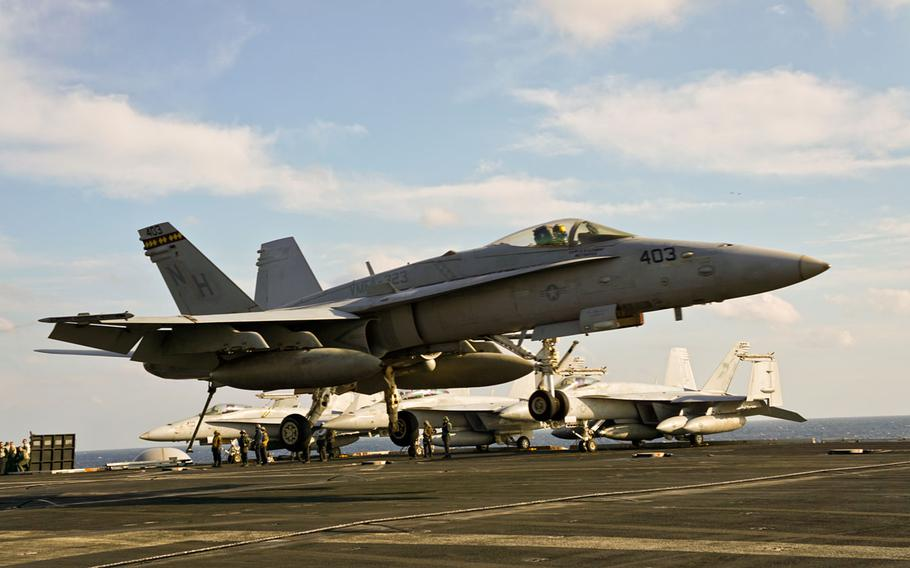 An F/A-18C Hornet assigned to Marine Fighter Attack Sqadron 323 lands on the flight deck of the aircraft carrier USS Nimitz during a tri-carrier exercise near the Korean Peninsula, Monday, Nov. 13, 2017.