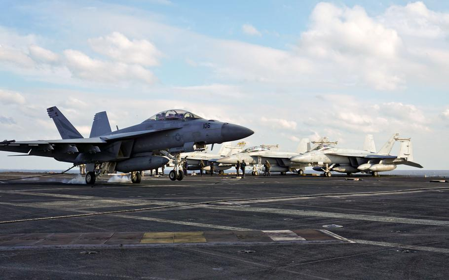 An F/A-18F Super Hornet assigned to Strike Fighter Squadron 154 catches the arresting cable aboard the USS Nimitz during the Navy's tri-carrier exercise east of the Korean Peninsula, Monday, Nov. 13, 2017.