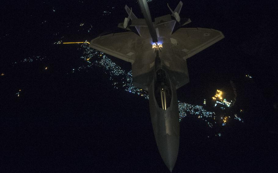 A 908th Expeditionary Air Refueling Squadron KC-10 Extender refuels an F-22 Raptor from the 95th Expeditionary Fighter Squadron in support of an offensive campaign in Afghanistan Nov. 19, 2017. Afghan National Defense and Security Forces and United States Forces-Afghanistan launched a series of ongoing attacks to strike drug labs and command-and-control nodes in northern Helmand province.
