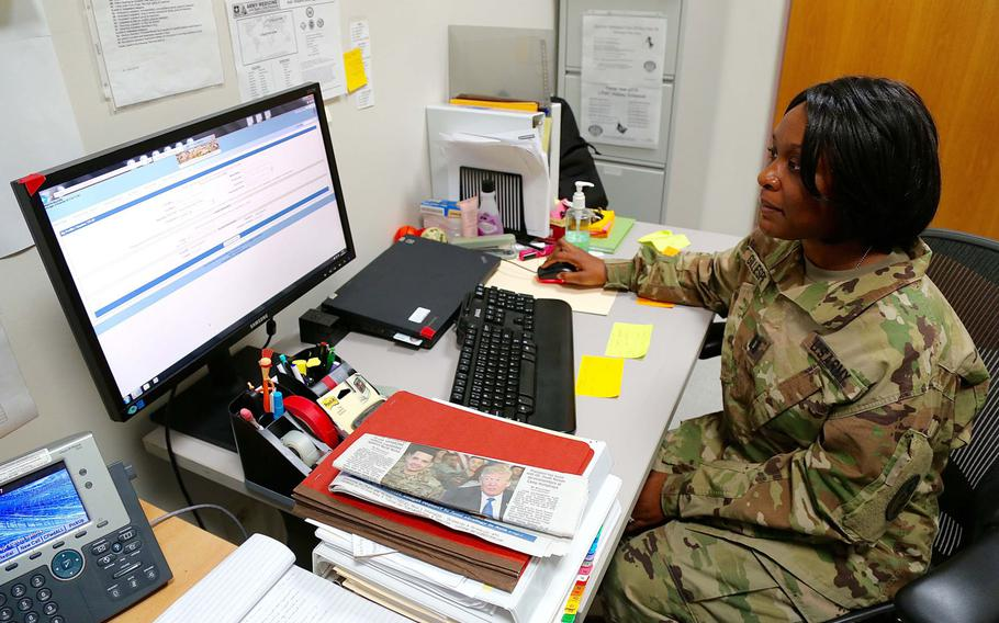 Army Capt. Marquita Gillespie, patient administration officer with the 7227th Medical Support Unit, shows how the Health Experts onLine Portal is used at Landstuhl Regional Medical Center. The 7227th used the portal to give soldiers deployed to forward areas access to medical specialists for treatment.