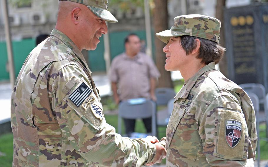 Army Maj. Gen. Robin Fontes, commander of Combined Security Transition Command-Afghanistan, right, thanks the outgoing command sergeant major of CSTC-A, Army Sgt. Maj. Bryan K. Schnell, for his work at a change-of-responsibility ceremony in Kabul on Sept. 14, 2017.