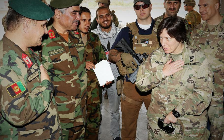 Army Maj. Gen. Robin Fontes, commander of Combined Security Transition Command-Afghanistan, right, meets with Maj. Gen. Monawari, commanding general of Afghan Logistics Command, far left, and Brig. Gen. Fahim, commander of the ANA Material Management Center-Afghanistan, on Aug. 9, 2017.