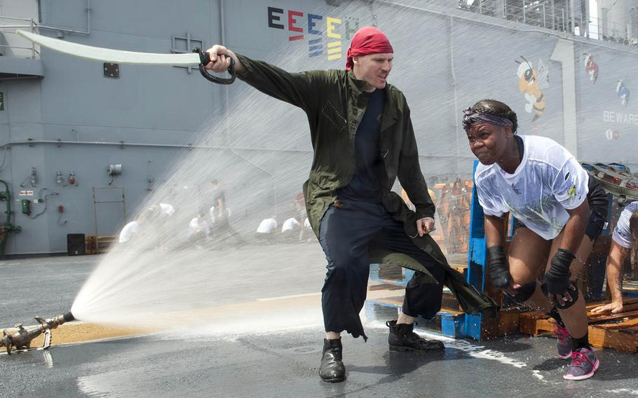 """""""Pollywogs"""" aboard the USS Wasp run an obstacle course to become """"shellbacks"""" during a crossing-the-line ceremony in the Atlantic Ocean, Saturday, Nov. 25, 2017."""