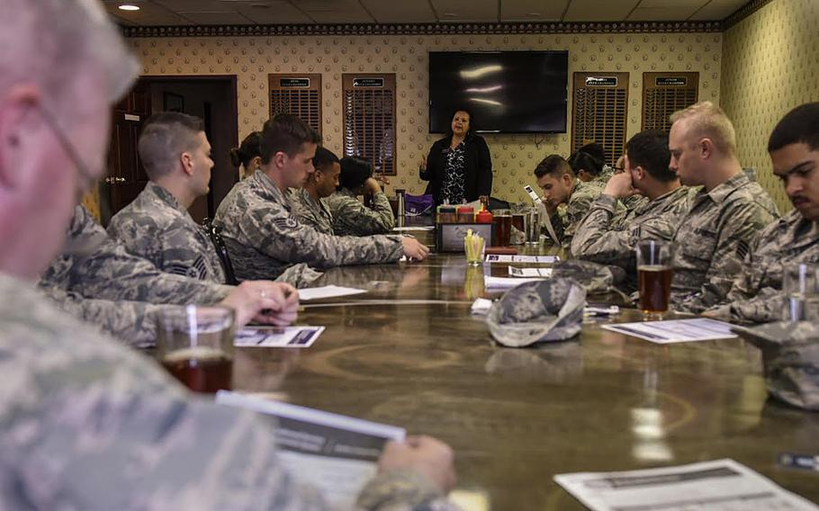 Patricia Maxwell, a personal financial counselor, talks to a group of airmen about the new Blended Retirement System at the Silver Spruce Golf Course on Peterson Air Force Base, Colo., April 21, 2017.