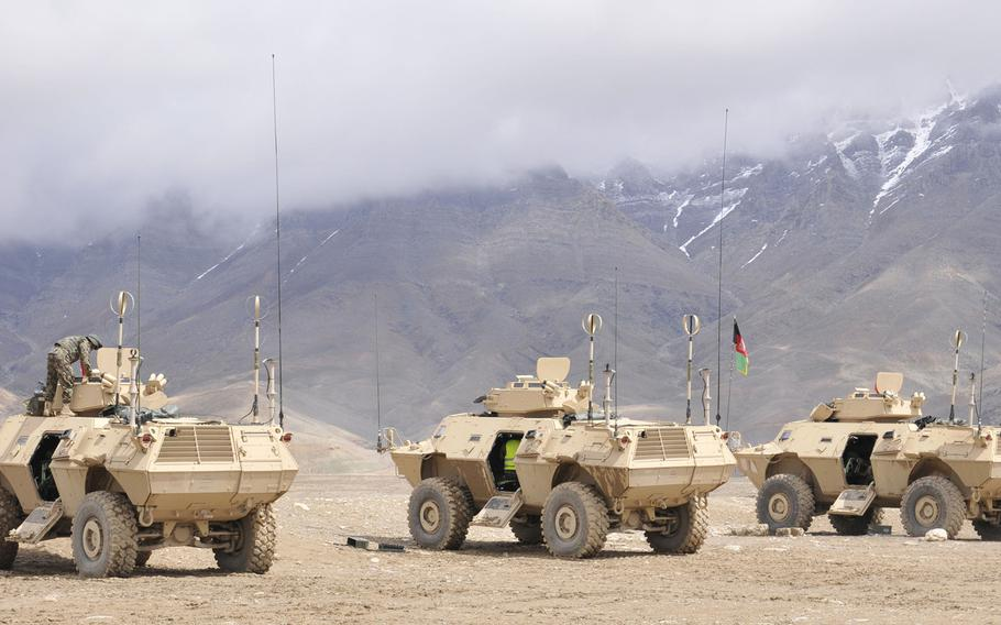The Afghan army's Armored Branch School conduct a demonstration of the capabilities of the Mobile Strike Force Vehicles, during a simulated attack, and a live fire exercise, using a mock up of the area in a sand pit near Kabul in 2014.