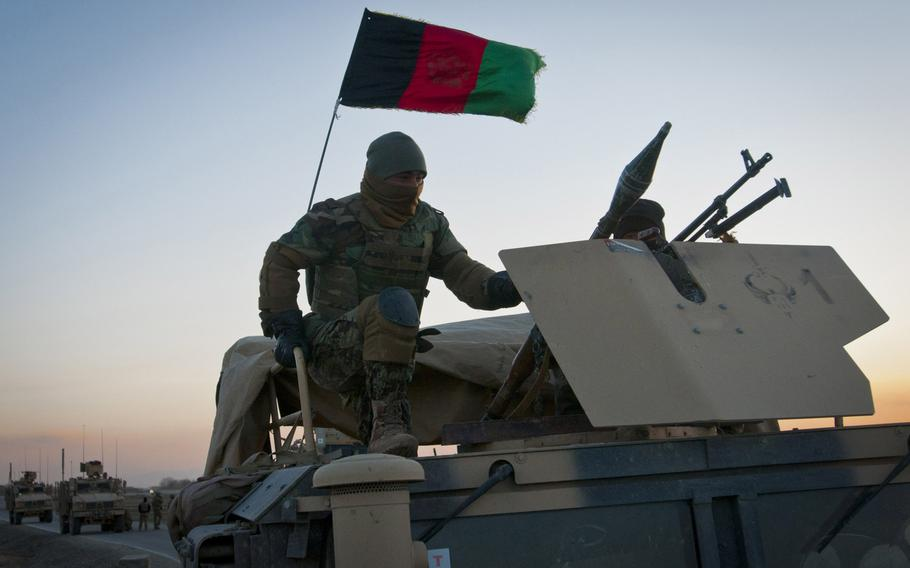An Afghan army soldier mans the gunner's turret of a Humvee in the early morning of March 8, 2012 in Paktika Province.