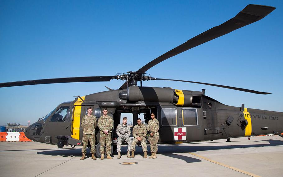 From left to right, Chief Warrant Officer 2 Nathan Gumm, pilot; Chief Warrant Officer 2 Eric Tirro, co-pilot; Spc. Carroll Moore, crew chief; Sgt. 1st Class Gopal Singh, flight medic; and Pfc. Karina Lopez, radio operator, pose at Camp Humphreys, South Korea, Thursday, Nov. 30, 2017.