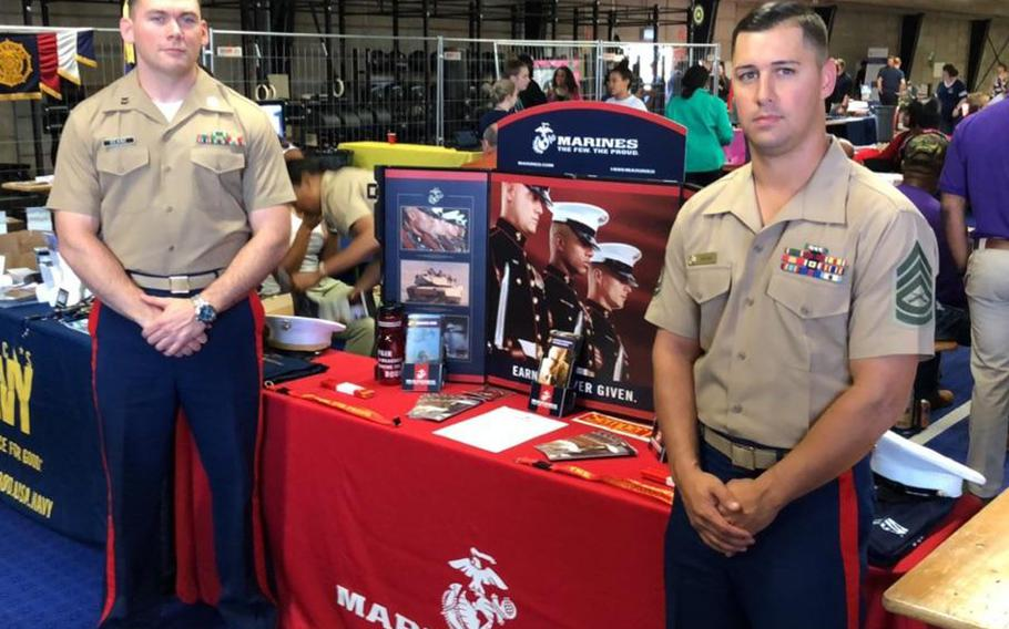Capt. Patrick Dean and Gunnery Sgt. Christopher Nieves at the Kaiserslautern Career Fair recently. The Marine Corps is opening its first full-time recruiting office outside the United States, in Kleber Kaserne, Germany, in February.
