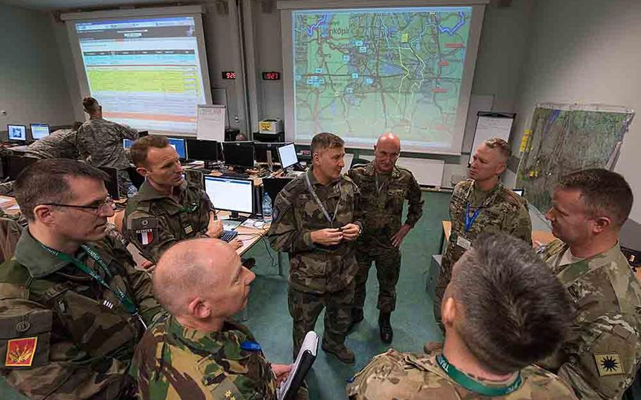 California National Guardsmen with the 40th Infantry Division work with French Rapid Reaction Corps soldiers during the opening of the Citadel Bonus mission in Bydgoszcz, Poland on Thursday, Dec. 7, 2017.