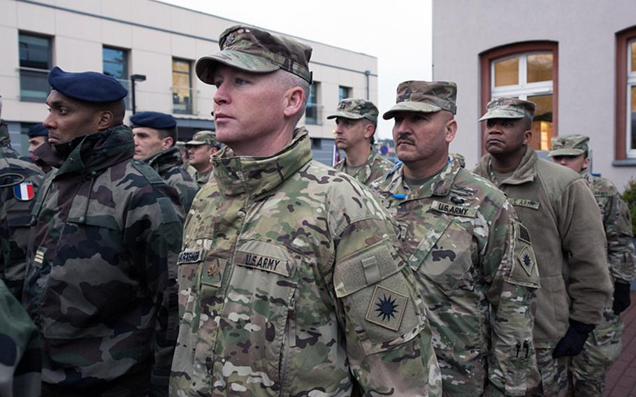 California National Guardsmen with the 40th Infantry Division stand beside French Rapid Reaction Corps soldiers during the opening ceremony for the Citadel Bonus mission in Bydgoszcz, Poland on Thursday, Dec. 4, 2017.