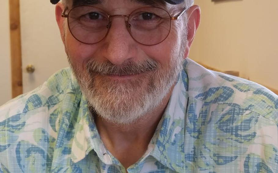 Vietnam veteran and poet John Musgrave wears a Purple Heart cap in this photo taken in July. After being shot in the face and chest in November 1967, sustaining life-threatening and permanently disabling injuries, Musgrave overcame severe post-traumatic stress and now helps to counsel post-911 veterans.  Photo courtesy of John Musgrave