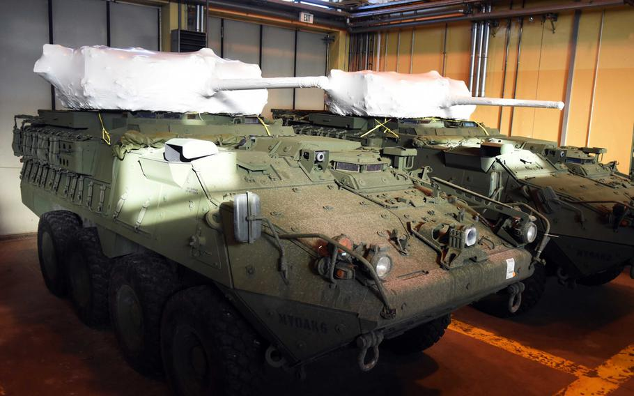 Two of the 2nd Cavalry Regiment's new upgunned Strykers with 30 mm cannons still wrapped, at Vilseck, Germany, Wednesday, Dec. 13, 2017.