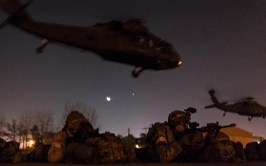 Soldiers with 1st Battalion, 5th Cavalry Regiment air-assault into Camp Stanley, South Korea, Friday, Dec. 15, 2017.