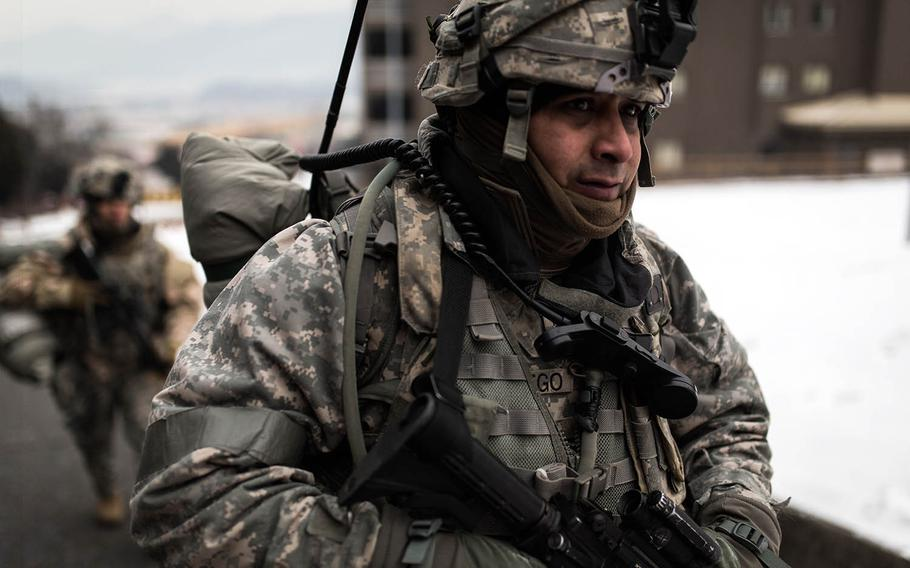 Soldiers from 1st Battalion, 5th Cavalry Regiment march through Camp Stanley, South Korea, Friday, Dec. 15, 2017.