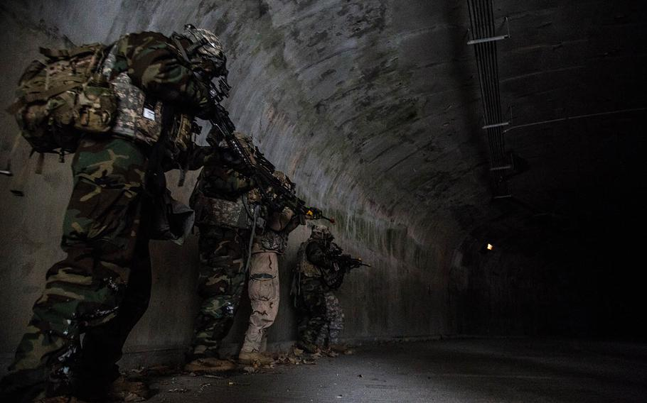 Soldiers from 1st Battalion, 5th Cavalry Regiment move into the underground facility at Camp Stanley, South Korea, Friday, Dec. 15, 2017.