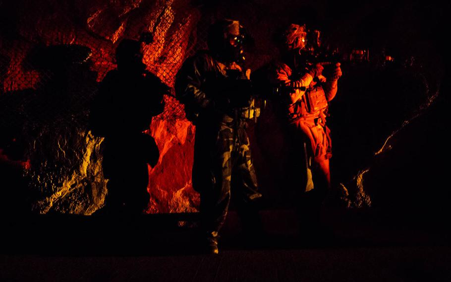 Soldiers from 1st Battalion, 5th Cavalry Regiment manuever through the underground facility at Camp Stanley, South Korea, Friday, Dec. 15, 2017.