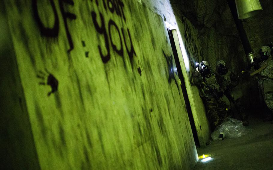 Soldiers from 1st Battalion, 5th Cavalry Regiment enter a suspected chemical weapons lab during a drill at Camp Stanley, South Korea, Friday, Dec. 15, 2017.