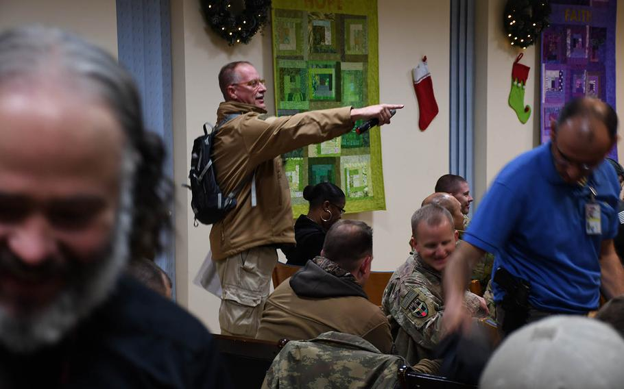 """Bill Ripley, general manager for AAFES in Afghanistan, calls on a soldier during a trivia game before a screening of """"Star Wars: The Last Jedi"""" at a base on Kabul's international airport on Saturday, Dec. 23, 2017."""