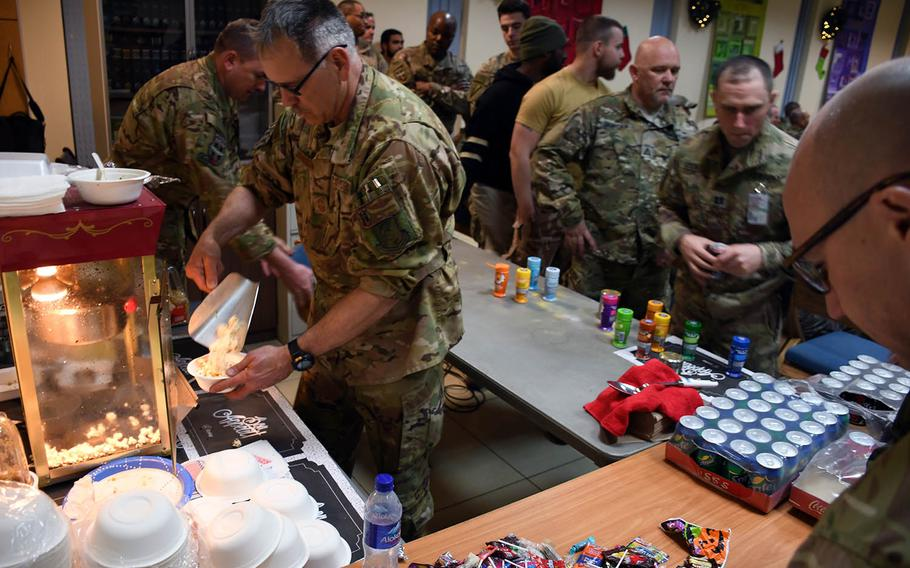 """Chief Master Sgt. Orin Johnson serves up popcorn for the troops at a screening of """"Star Wars: The Last Jedi"""" at a coalition base's chapel at Hamid Karzai International Airport in Kabul, Afghanistan, on Saturday, Dec. 23, 2017."""